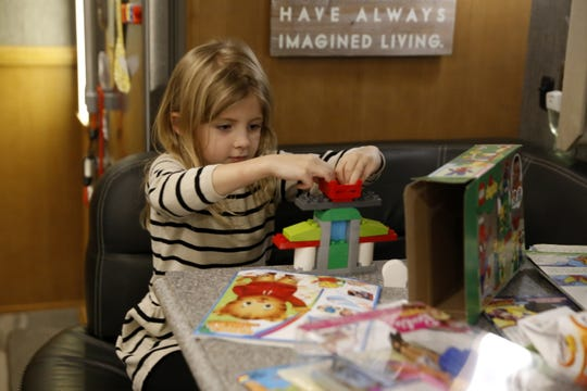 Mary Catherine builds a Lego structure Friday while visiting Farmington.