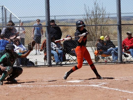 Aztec's Alanna Larkins makes contact at the plate against Farmington during a doubleheader on Saturday, April 14, 2018 at the Aztec Tiger Sports Complex. Aztec opens the 2019 season with its home tournament on March 1 and 2.
