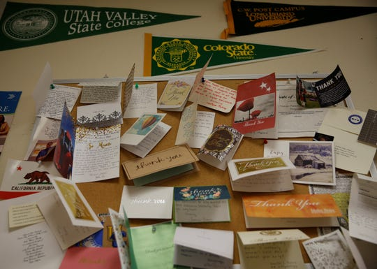 Thank you cards from scholarship recipients to the Office of Navajo Nation Scholarship and Financial Assistance are displayed in an employee's office in Window Rock, Ariz.
