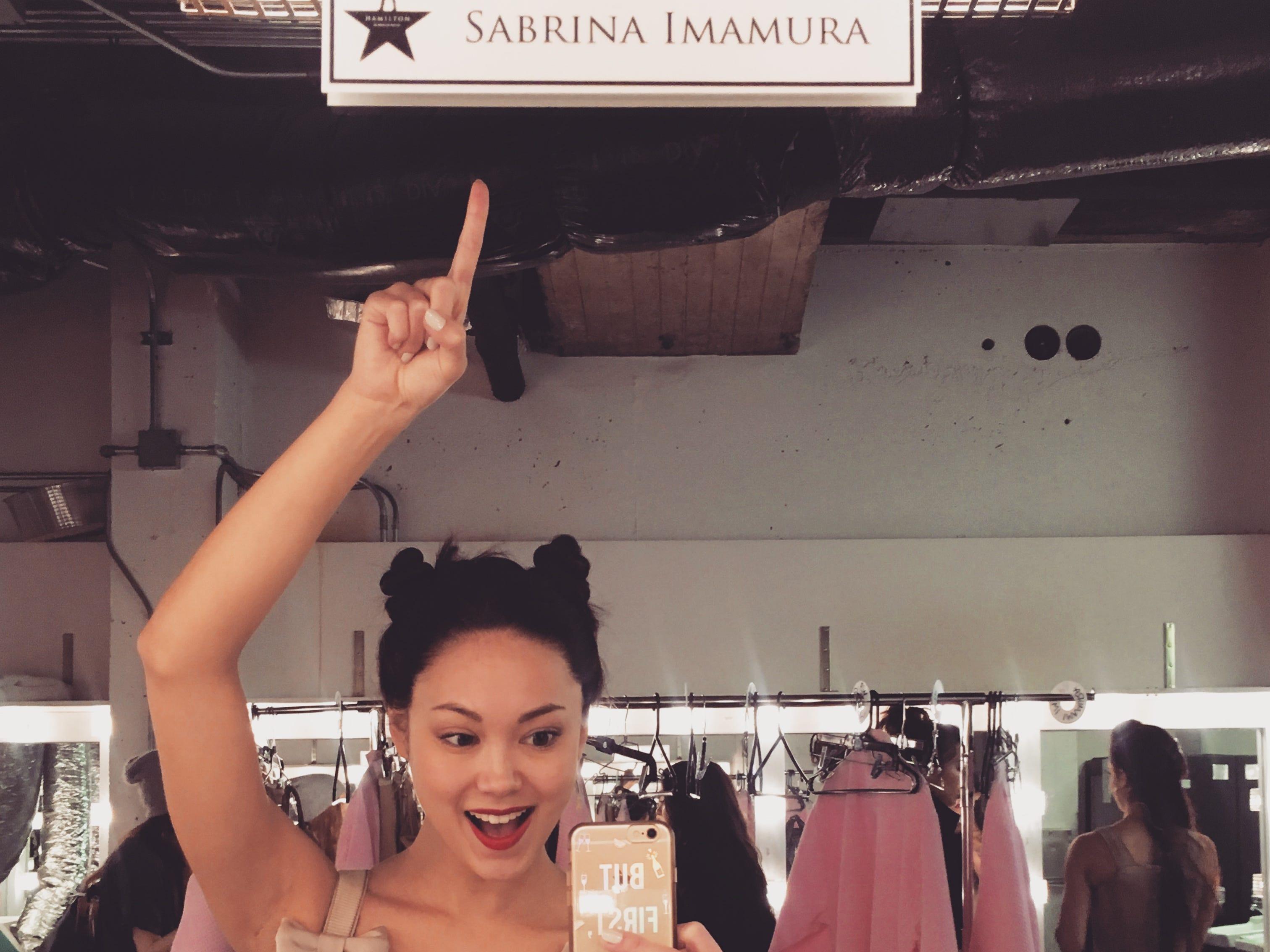 Sabrina Imamura takes a backstage selfie.