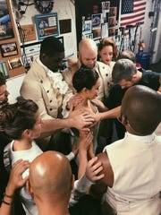 Hamilton cast members pray with Sabrina Imamura (center) prior to her debut.