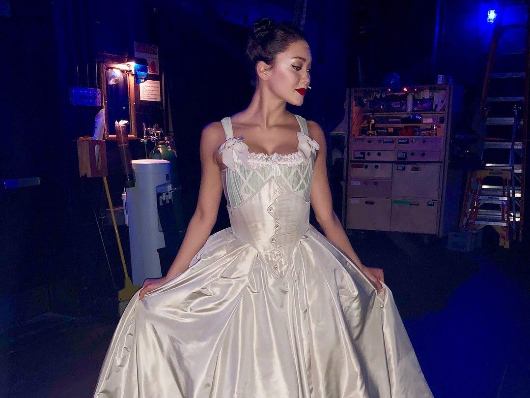 Sabrina Imamura posing in her Hamilton dress.