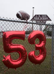 Tate High School pays tribute to sophomore Sean Banks, who was No. 53 on the school's football team. Banks and his older sister, Antoinette McCoy, were killed by a suspected drunken driver early Saturday.