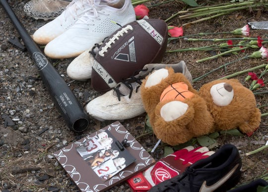 A roadside memorial on Kingsfield Road pays tribute to Tate High School sophomore Sean Banks and his older sister, Antoinette McCoy, who were killed by a suspected drunken driver early Saturday.