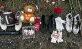 A roadside memorial, including roses, crosses and athletic equipment, was made to honor the lives of two siblings killed by a suspected drunk driver.
