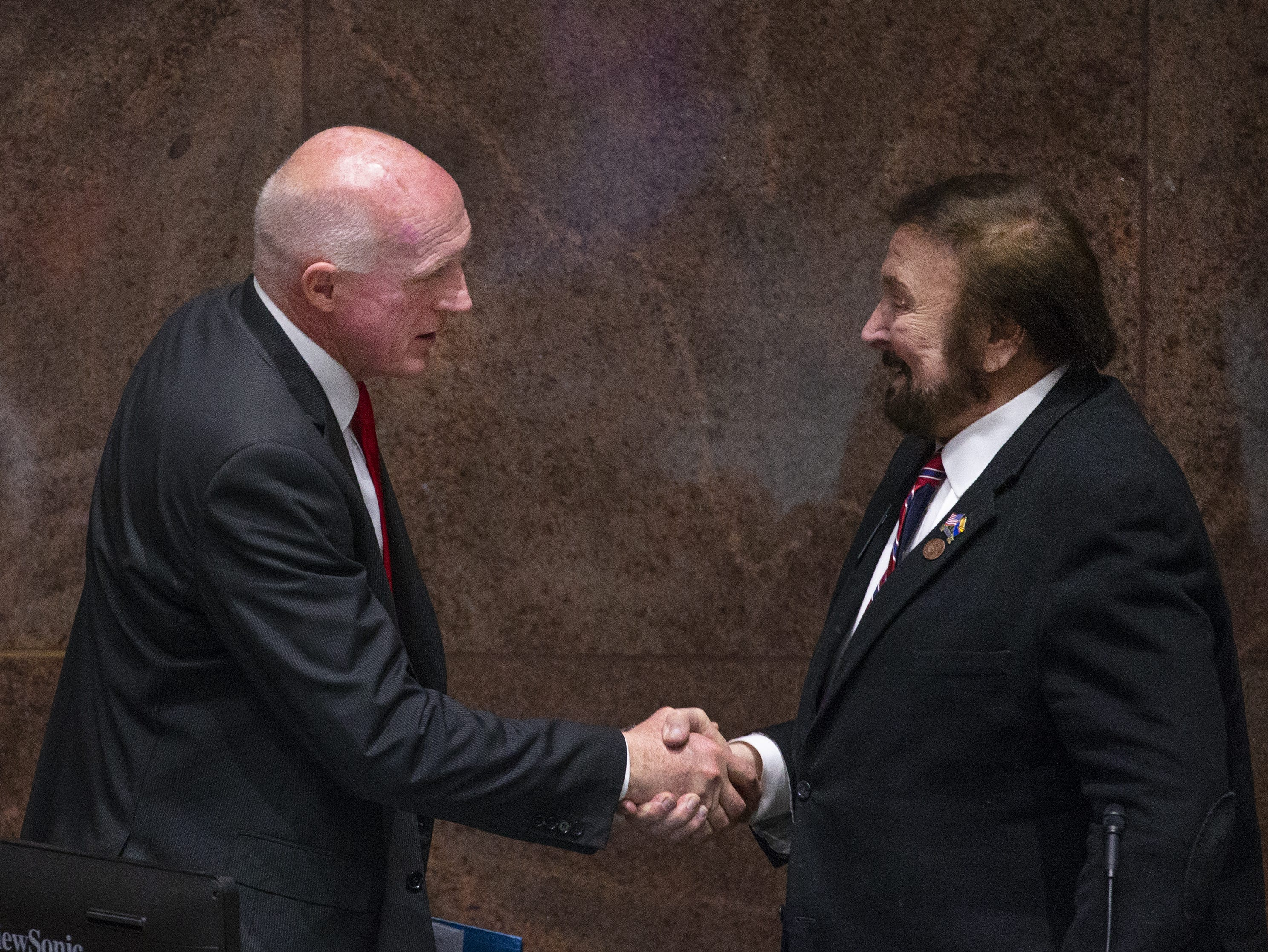 State Rep. Rusty Bowers, R-Mesa,  is congratulated by Rep. Jay Lawrence, R-Scottsdale, as Bowers takes his seat as House Speaker. Gov. Doug Ducey will deliver his State of the State address to the Legislature and guests gathered in the House of Representatives at the State Capitol, Jan. 14, 2019.