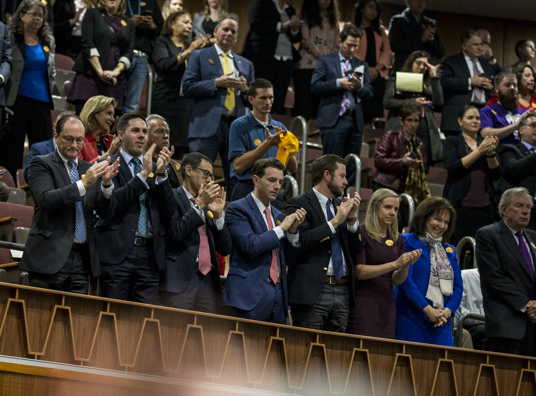 People in the gallery applaud during Gov. Doug Ducey's State of the State address on  Jan. 14, 2019, at the Arizona House of Representatives Chambers in Phoenix.
