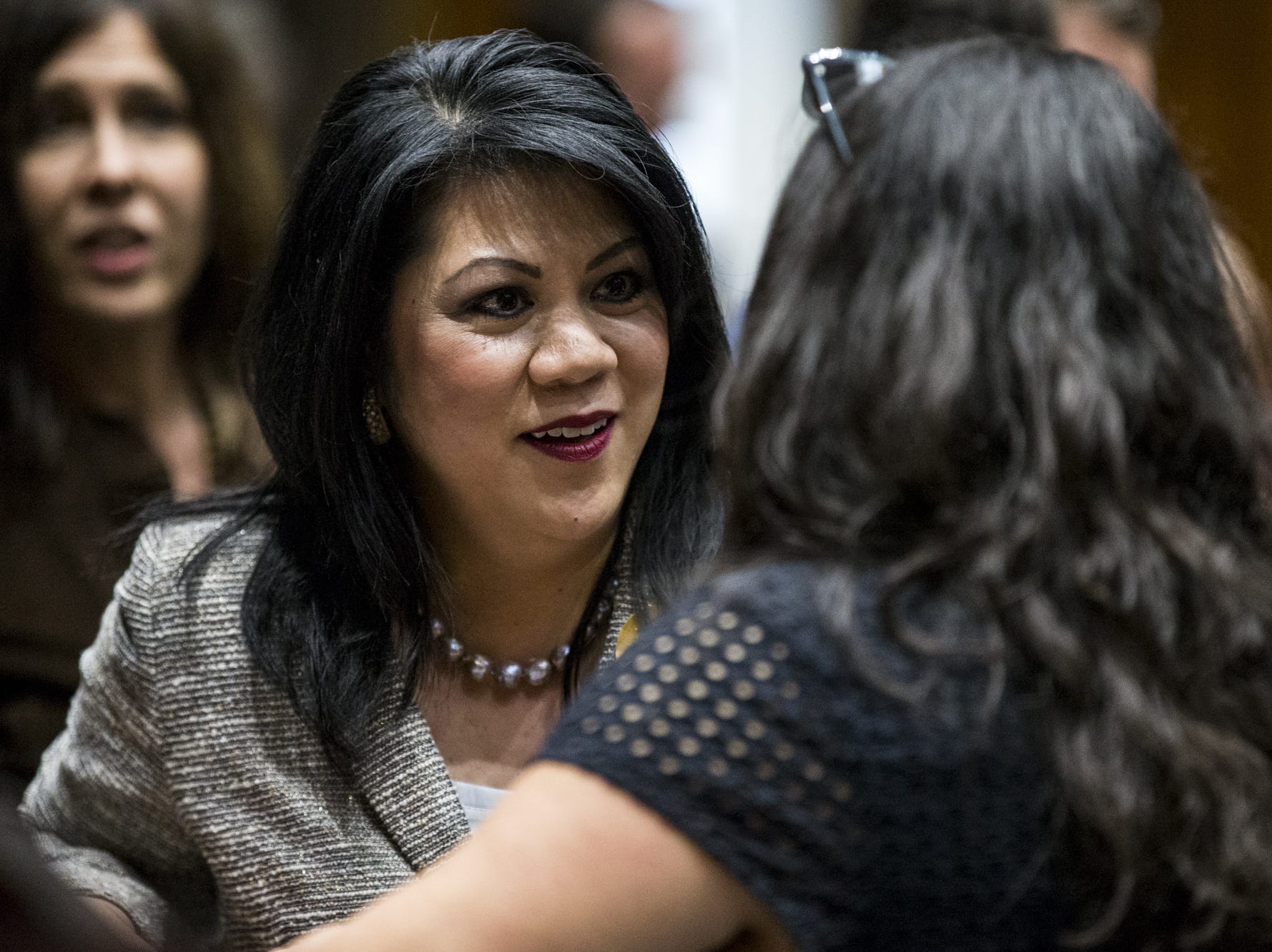 State Treasurer Kimberly Yee talks with people on the floor before the State of the State on Jan. 14, 2019, at the Arizona House of Representatives Chambers in Phoenix.
