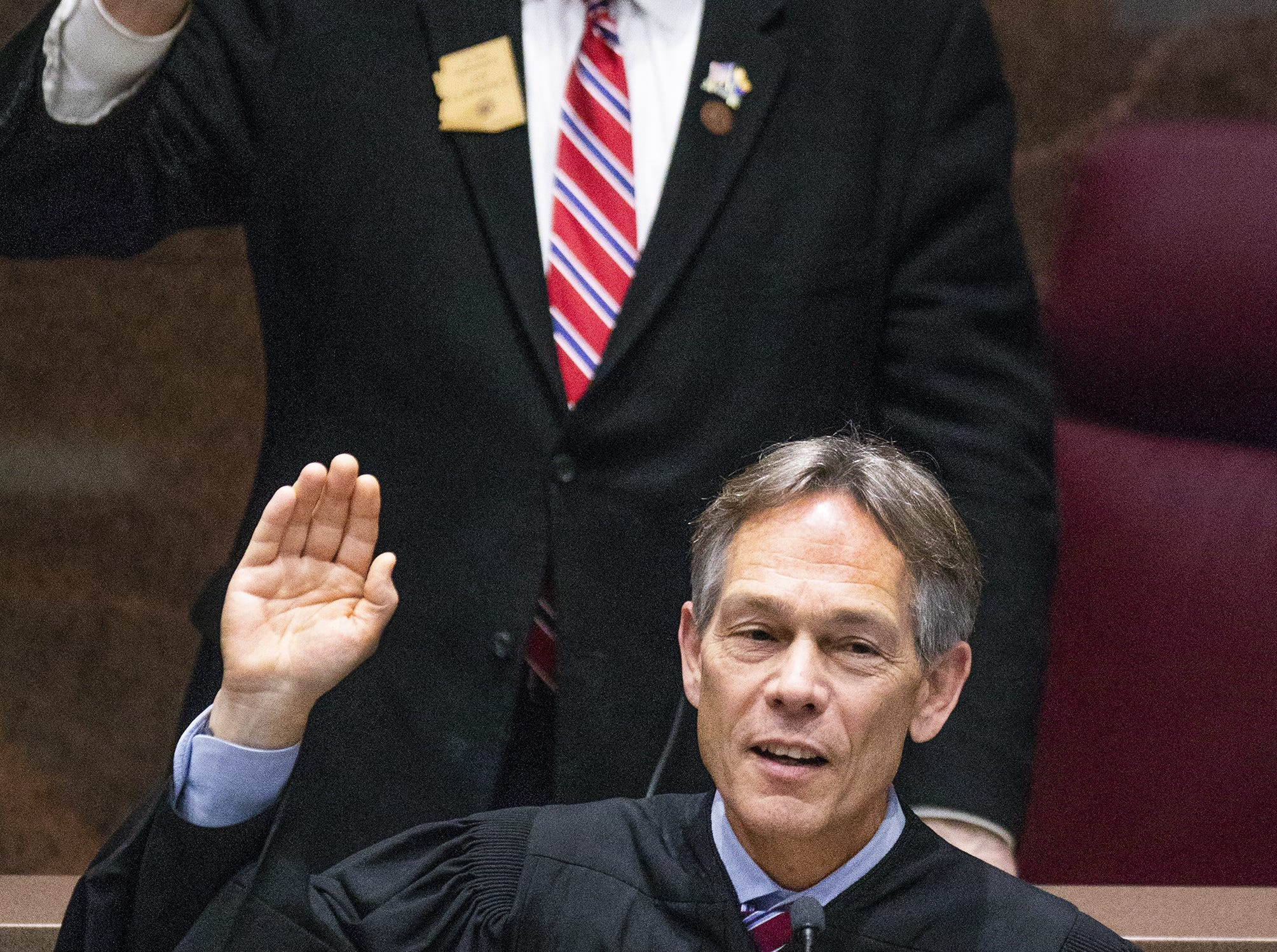 Arizona Supreme Court Chief Justice W. Scott Bales administers the oath of office before Gov. Doug Ducey's State of the State address to the Legislature and guests gathered in the House of Representatives at the Arizona state Capitol on Jan. 14, 2019.