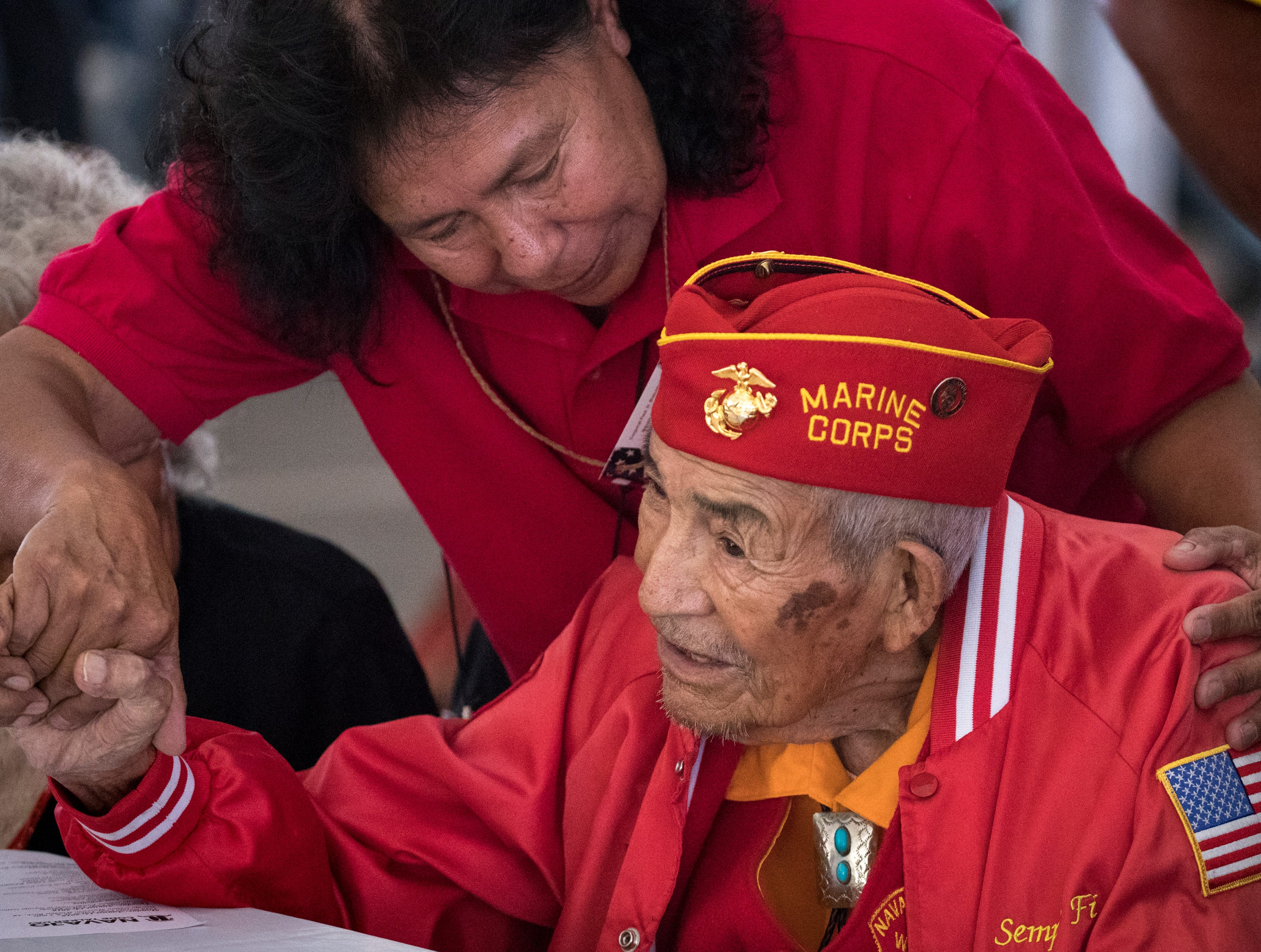 Navajo Code Talker Alfred Newman is greeted by granddaughter Yvonne Tso during the Navajo Nation Code Talkers Day ceremony Aug. 14, 2018, at the Veterans Memorial Park in Window Rock.