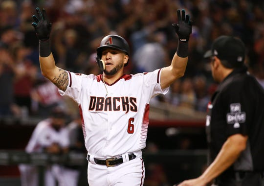 David Peralta hits a home run against the Los Angeles Dodgers in the seventh inning on Sep. 26, 2018, at Chase Field in Phoenix, Ariz.