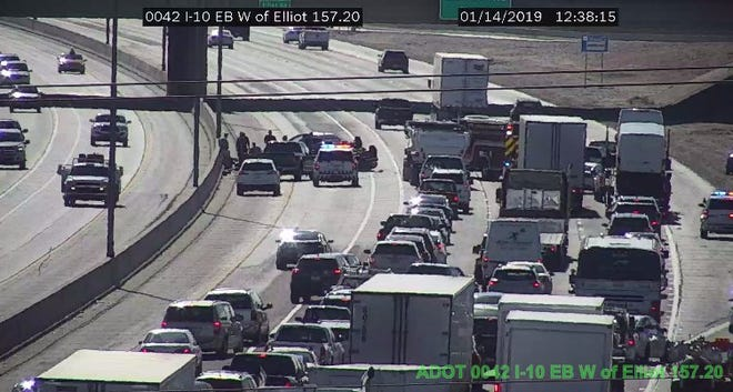A rollover on I-10 eastbound caused major traffic delays in Phoenix, Jan. 14, 2018.