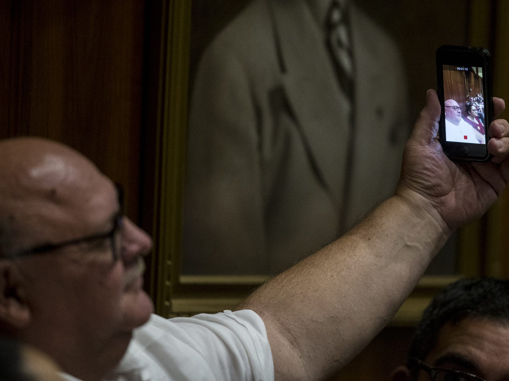A guest takes a video during Opening Day of the Legislature on Jan. 14, 2019, at the Arizona House of Representatives Chambers in Phoenix.
