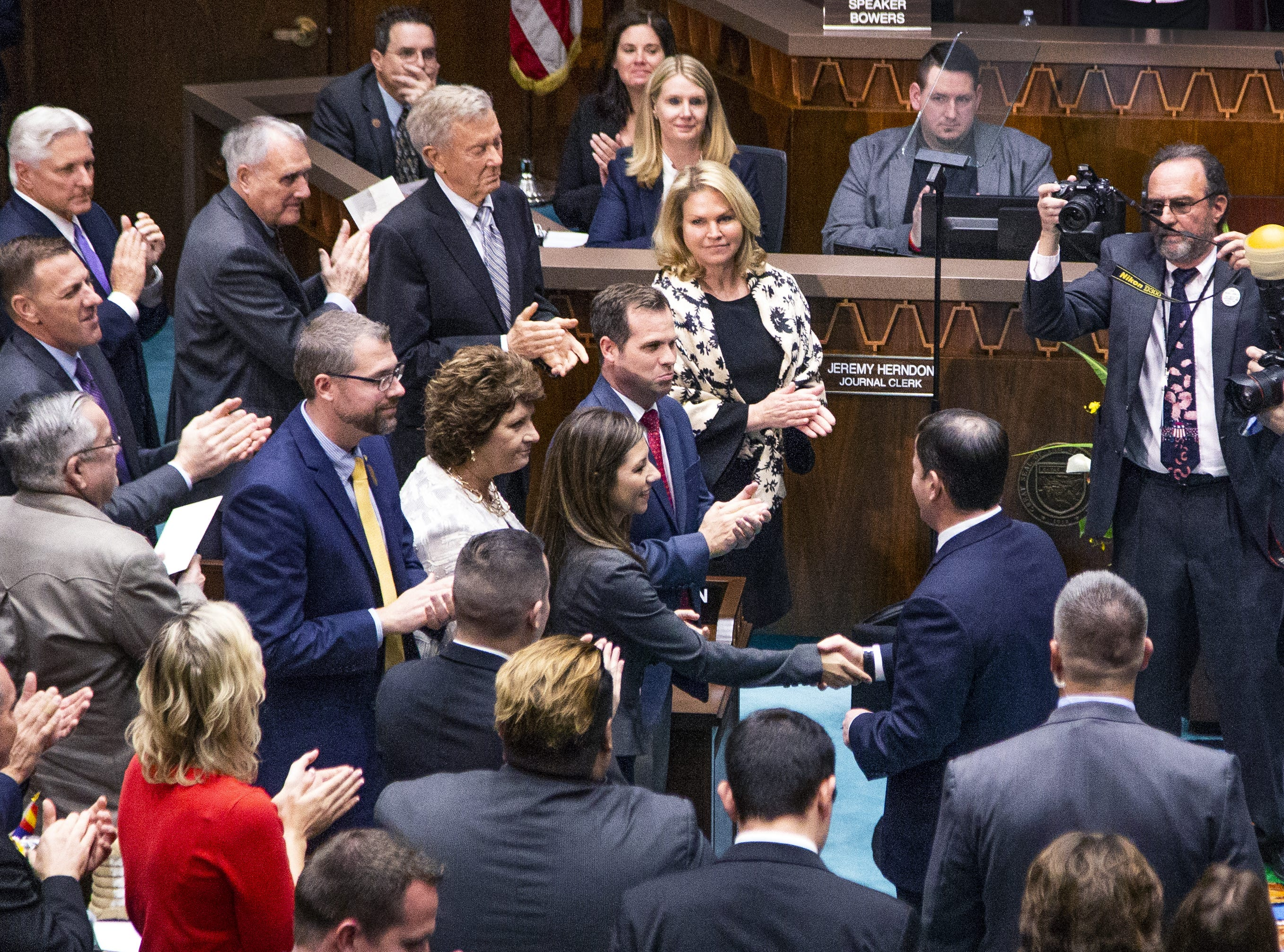 Gov. Doug Ducey enters the House chamber to deliver his State of the State address to the Legislature and guests gathered at the State Capitol on Jan. 14, 2019.