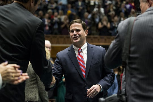 Gov. Doug Ducey enters the House Chambers during the State of the State on Jan. 14, 2019, at the Arizona House of Representatives Chambers in Phoenix.