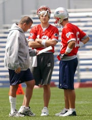 New Arizona Cardinals coach Kliff Kingsbury (right), played with New England Patriots quarterback Tom Brady.