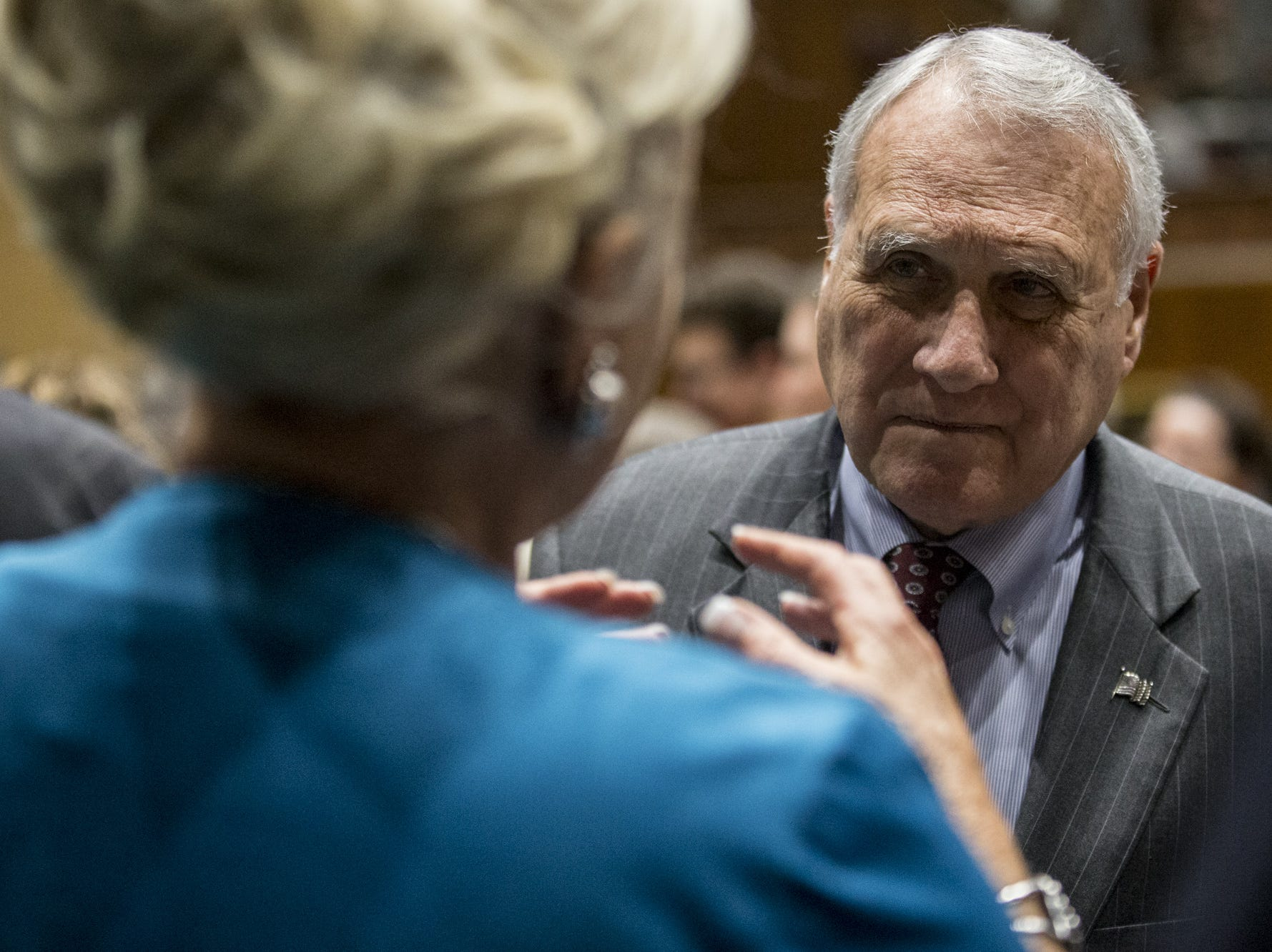 Former Arizona Senator Jon Kyl talks with people on the floor before the State of the State on  Jan. 14, 2019, at the Arizona House of Representatives Chambers in Phoenix.