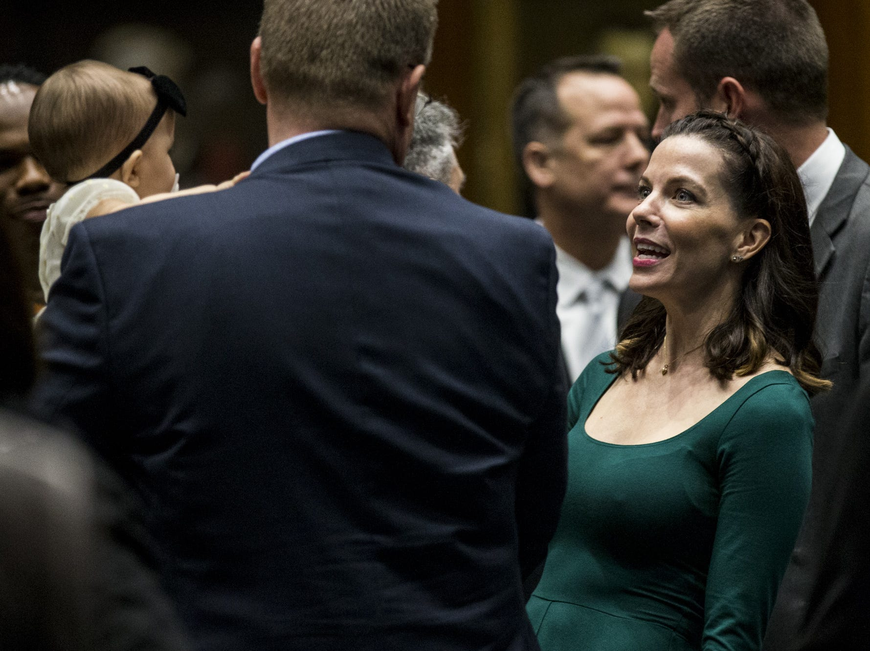 Rep. Michelle Ugenti-Rita talks with people on the floor before the State of the State on Jan. 14, 2019, at the Arizona House of Representatives Chambers in Phoenix.