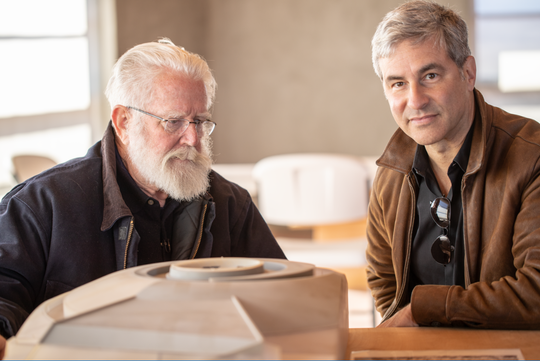 James Turrell (left) shows Michael Govan, president of the Skystone Foundation, a model of one of the spaces at Roden Crater.