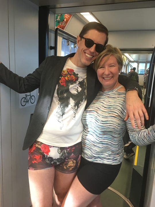 Jeff Moriarty (left) and his wife Dannie pose for a picture together on the westbound light rail during No Pants Day, Jan. 13, 2019. They are part of Improv AZ, the group that brought this annual event to Phoenix.