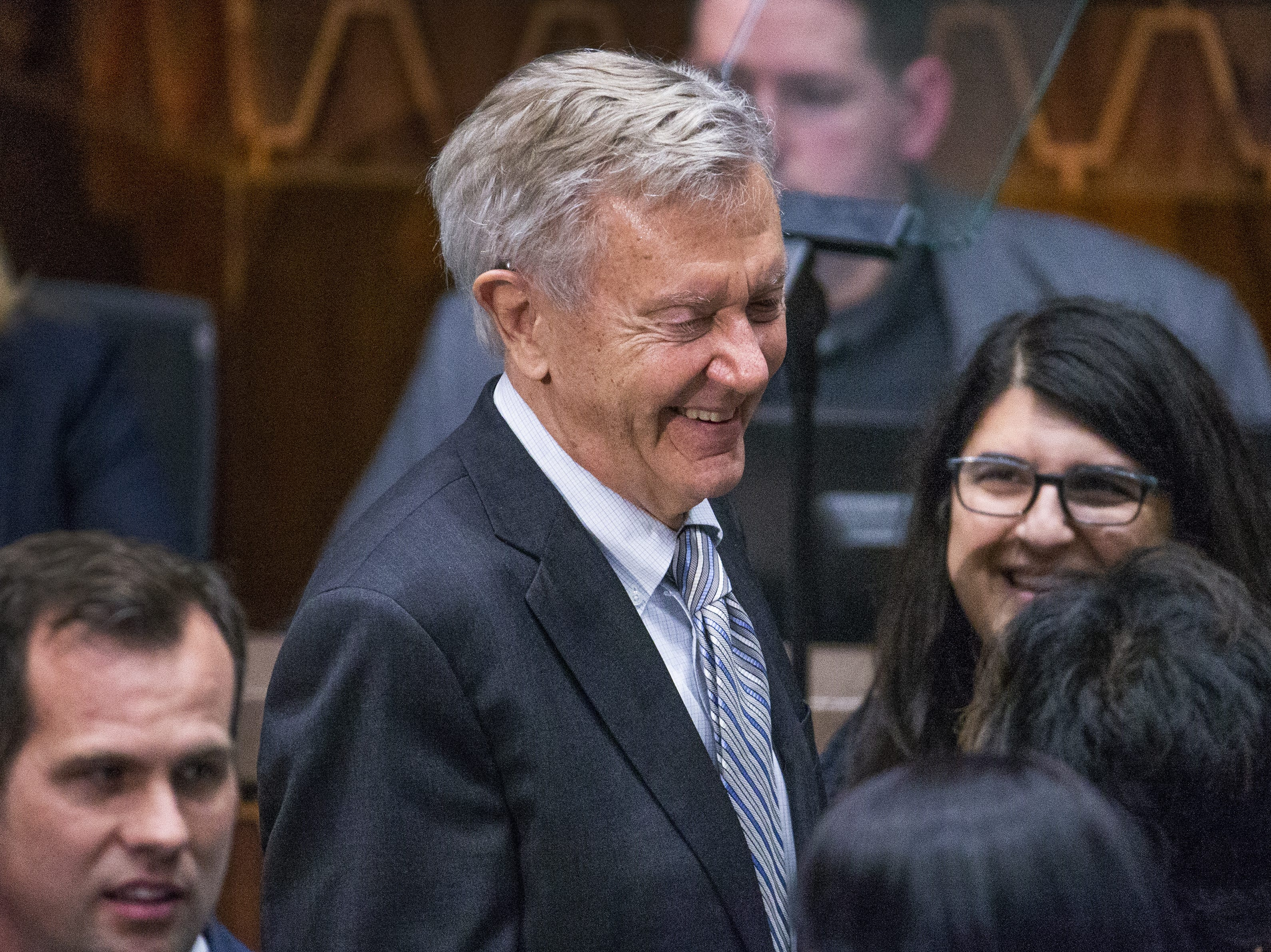 Former Gov. Bruce Babbitt mingles on the floor of the House of Representatives before Gov. Doug Ducey's State of the State address to the Legislature and guests gathered at the Arizona state Capitol on Jan. 14, 2019.