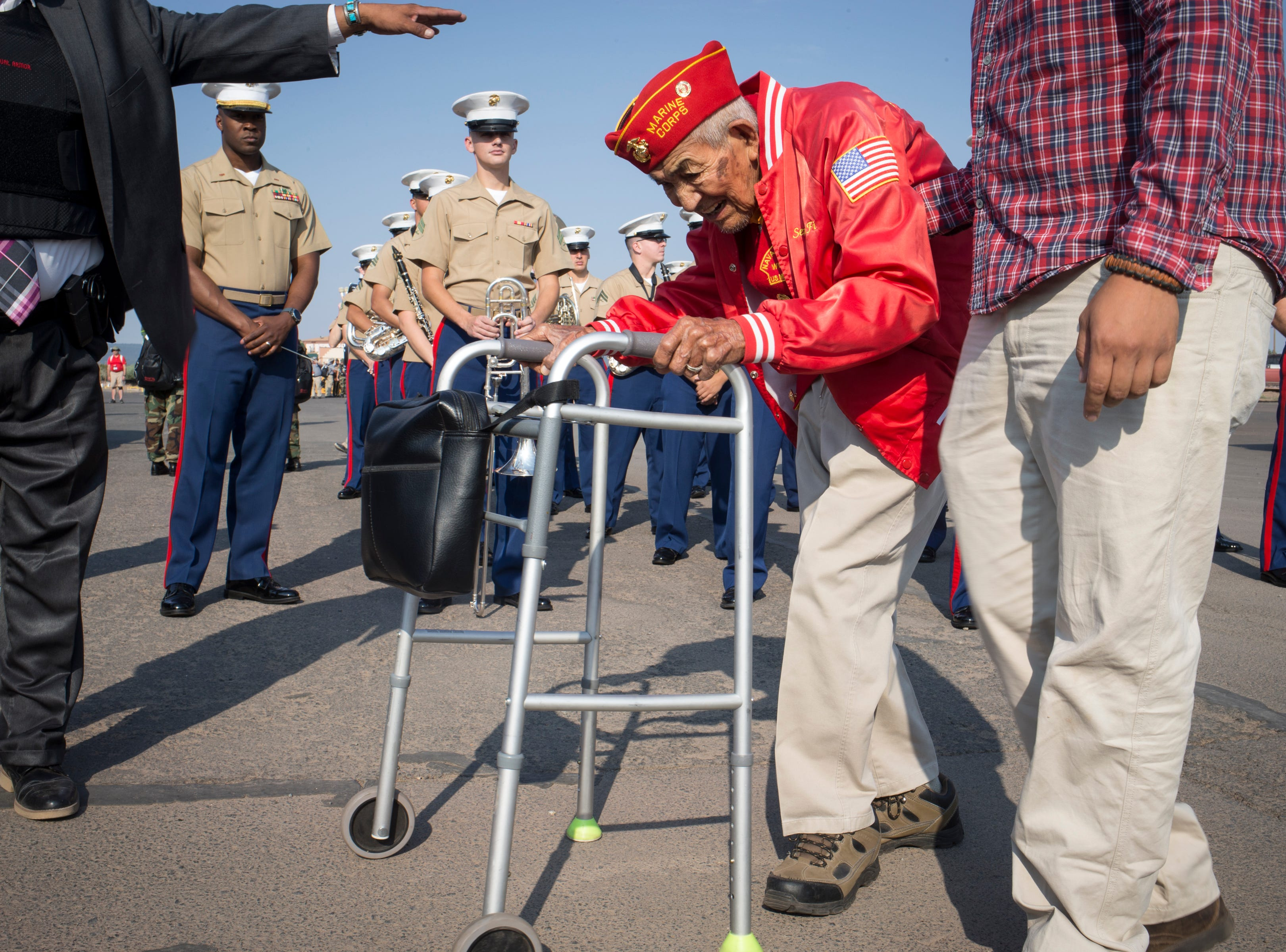 Navajo Code Talker Alfred Newman is helped to his vehicle by his grandson William Newman before the start of the Navajo Nation Code Talkers Day parade Aug. 14, 2018, at the Navajo Nation Fairgrounds in Window Rock.
