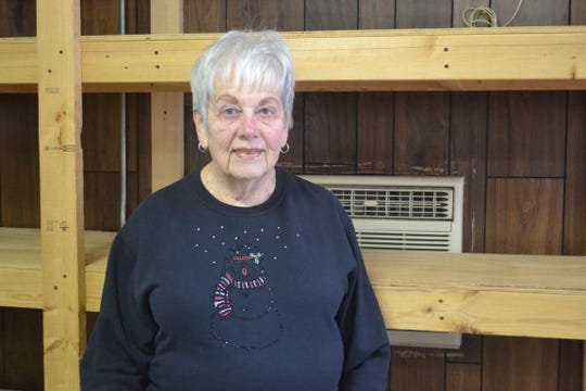 Alice Fork, the pantry's chairwoman, stands in front of empty shelves at the Woodville food pantry. Even though monetary and food donations pour in from all across the town, the pantry is always in need of more.