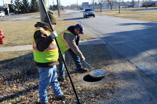 From left, Marysville Department of Public Works utilities Randy Smith and Jake Godlewski conduct maintenance checks of the city's water line valves on Jan. 14, 2018.