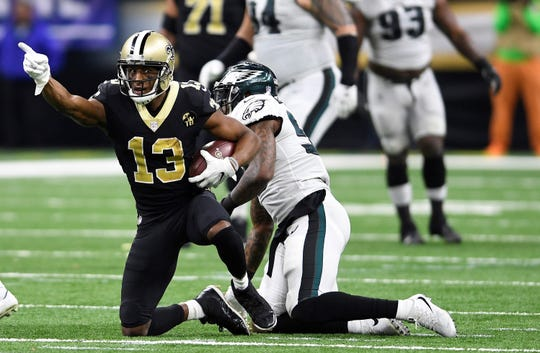 New Orleans Saints wide receiver Michael Thomas (13) celebrates a first down reception in the second half of an NFL divisional playoff football game against the Philadelphia Eagles in New Orleans, Sunday, Jan. 13, 2019. (AP Photo/Bill Feig)