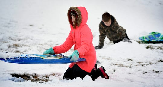 Kate Navratil, 11, left, and her brother Tyler, 12, both of Spring Garden Township, build a snow jump while sledding at Reservoir Park in the township Sunday, Jan. 13, 2019. More snow is in the forecast for the area later this week. Bill Kalina photo