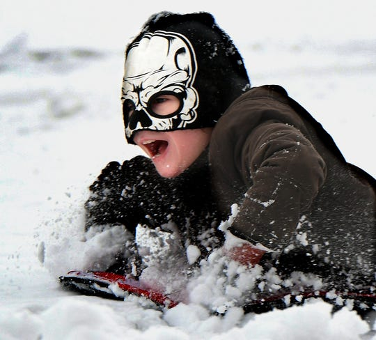 Strummer Manning, 9, of York City, sleds at Reservoir Park in Spring Garden Township Sunday, Jan. 13, 2019. More snow is in the forecast for the area later this week. Bill Kalina photo