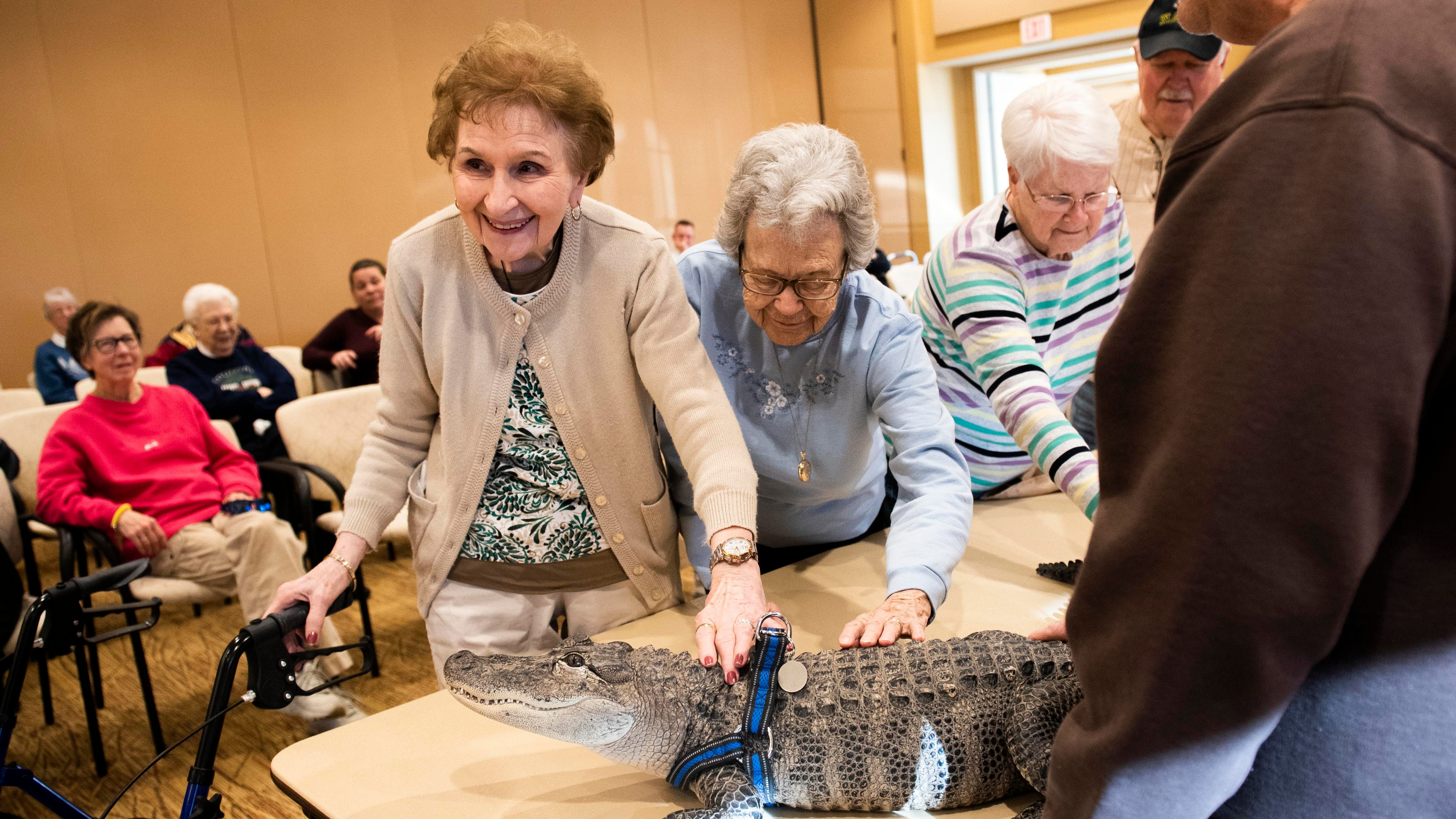 Gloria Watson, left, and Alice Brown pet Wally, a...