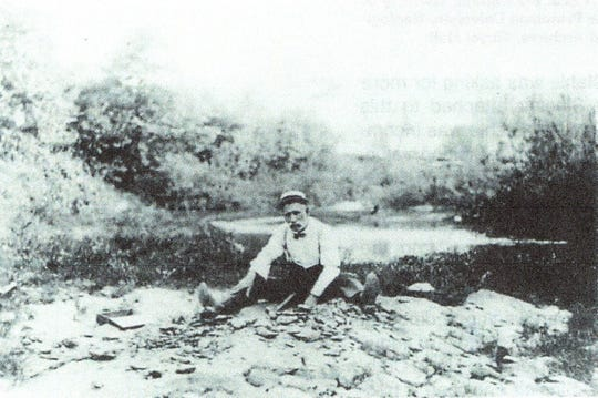 Dr. Robert Stahle in the 1910 historic photograph at the bone bed site.