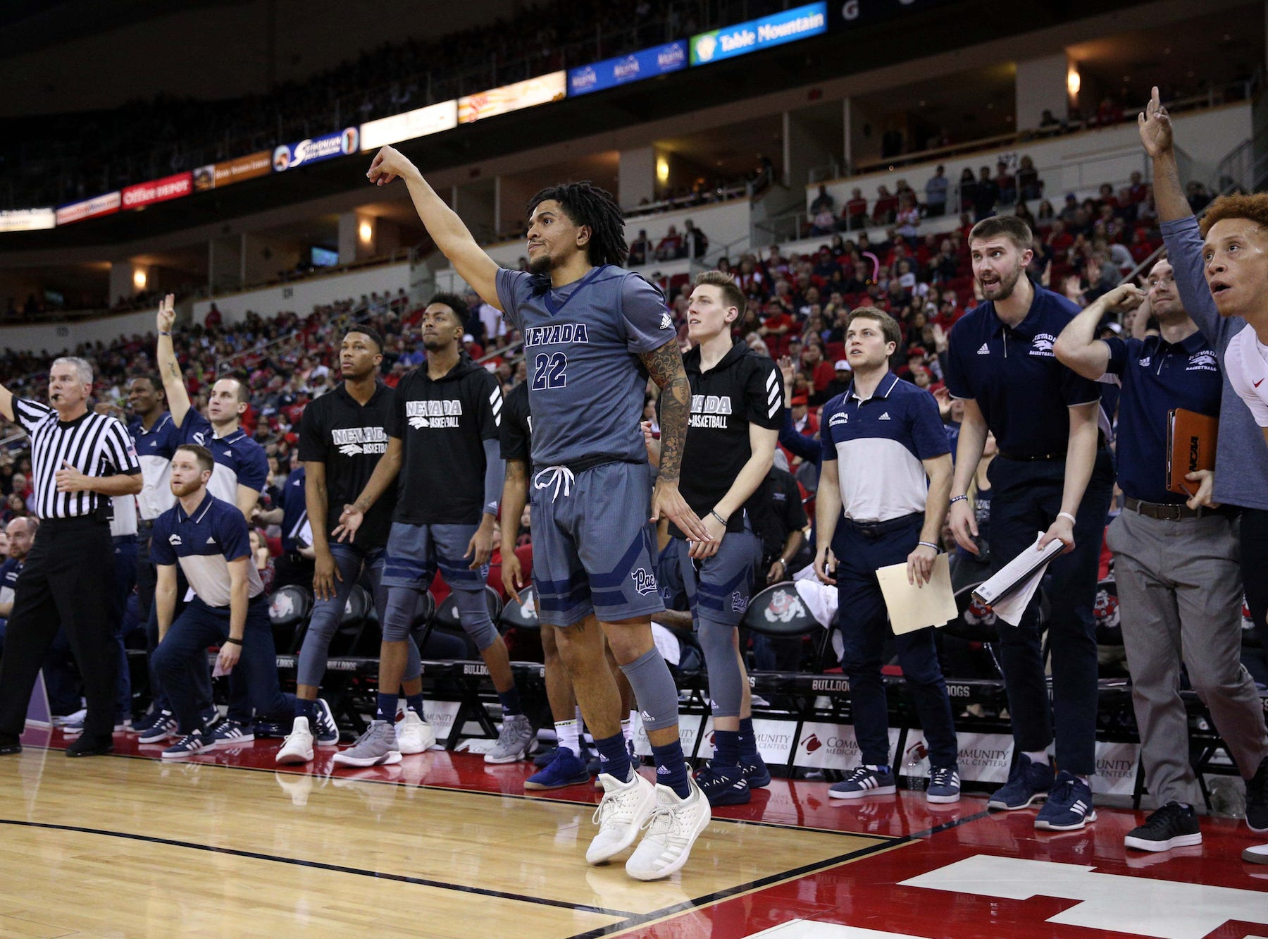 Nevada guard Jazz Johnson reacts after hitting a corner 3-pointer against Fresno State on Saturday.