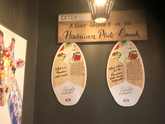 Skimboards mounted at the new Kenji's restaurant in South Reno detail the history of the Hawaiian plate lunch, a signature Kenji's dish.
