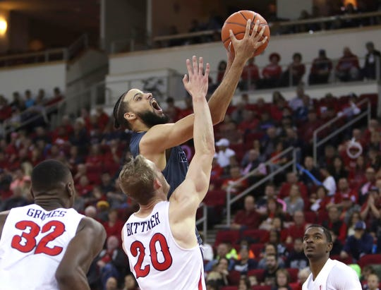 Nevada's Caleb Martin get a shot off against the Fresno State defense on Saturday afternoon.