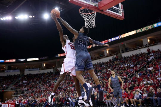 Fresno State's Nate Grimes (32) has his shot blocked by Nevada's Jordan Caroline during the Wolf Pack's win last month..