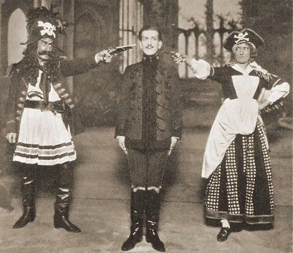 """The Pirates of Penzance,"" in a 1919 production. Fredric (James Hay, center) comes under the gun when he learned that his birthday was on a leap year"