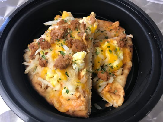 A breakfast pizza is one of the dishes offered by Savage Chef in Webster.