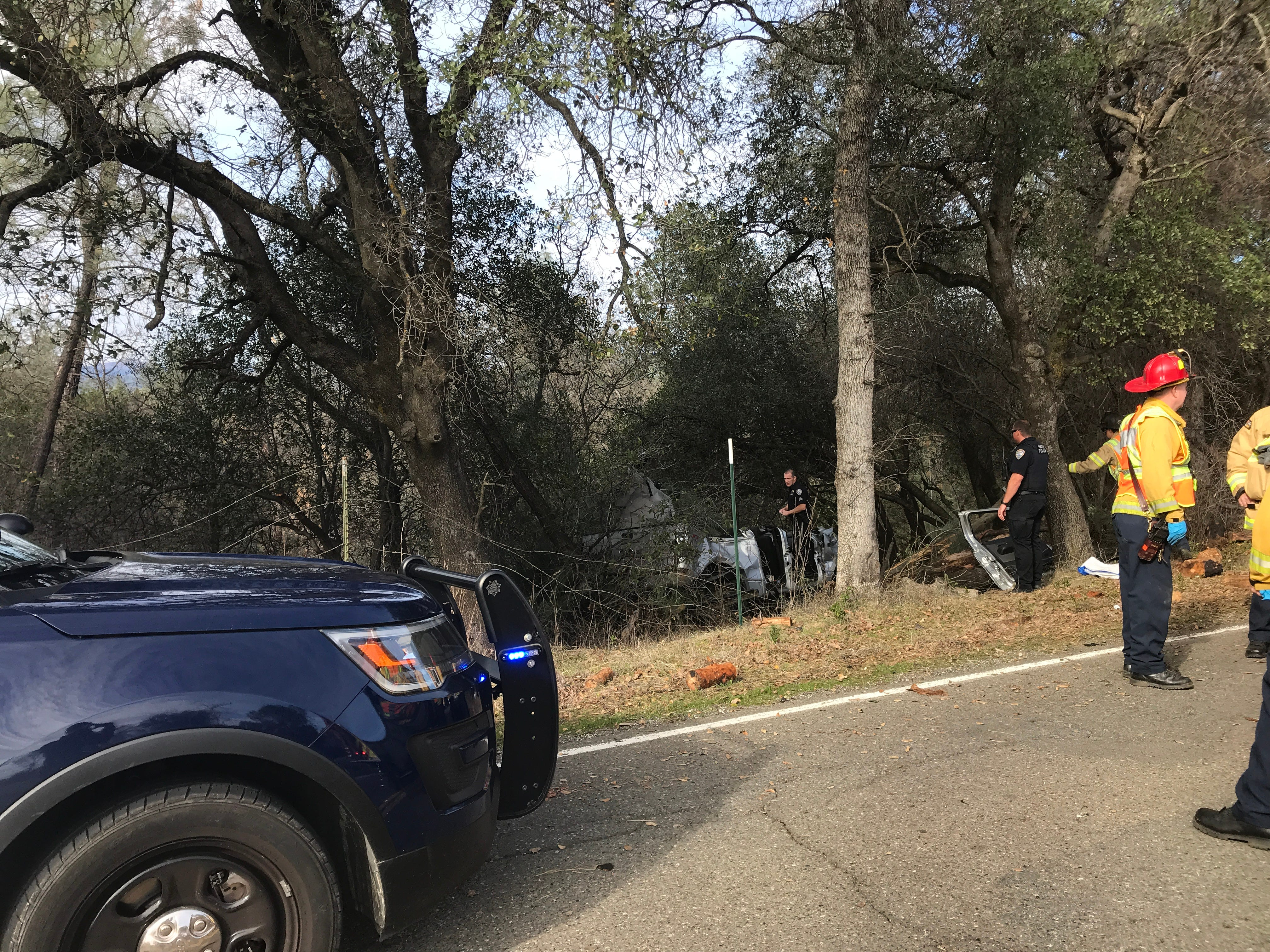 Redding police officers and firefighters work the scene of a fatal wreck on Old Oregon Trail on Monday, Jan. 14, 2019.