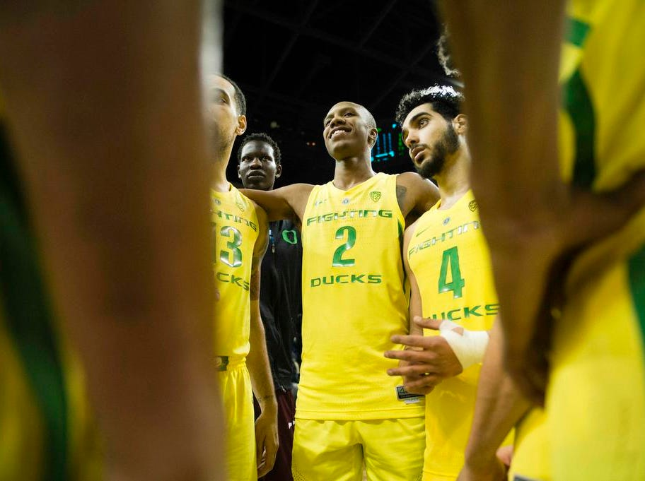 Jan 13, 2019; Eugene, OR, USA; Oregon Ducks forward Louis King (2) and guard Ehab Amin (4) celebrate with teammates after a game against the USC Trojans at Matthew Knight Arena. The Ducks beat the Trojans 81- 60. Mandatory Credit: Troy Wayrynen-USA TODAY Sports