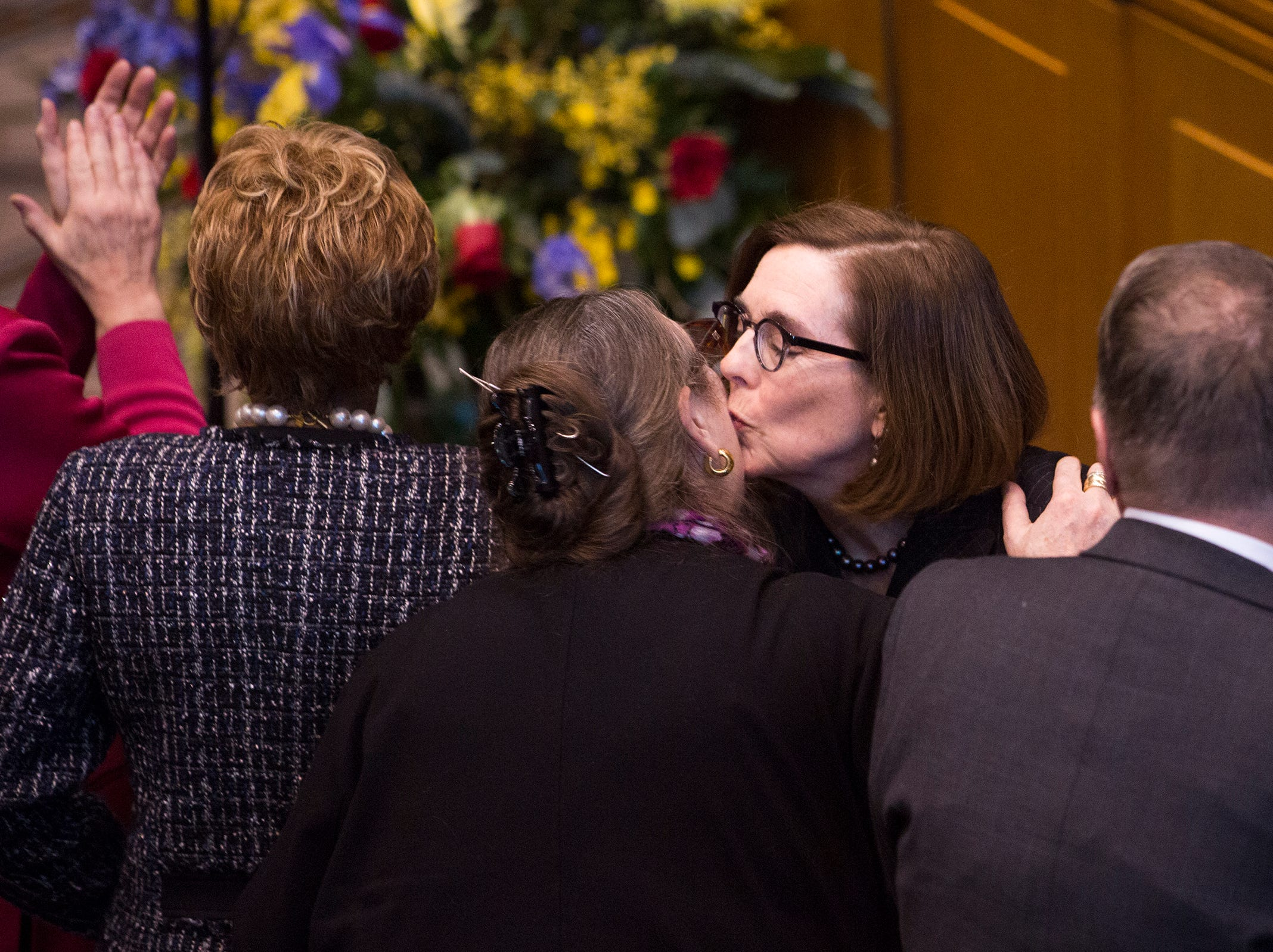 Governor Kate Brown greets members of the Senate at her inauguration at the Oregon State Capitol on Jan. 14, 2019.