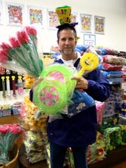 Centaur Bead Room Chief Ricky Bridges shows off  throws and other items sold in the room.