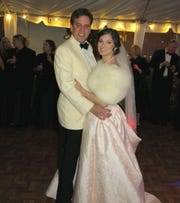 Delton Smith and Caroline Wiggins  during their first dance at the wedding reception.