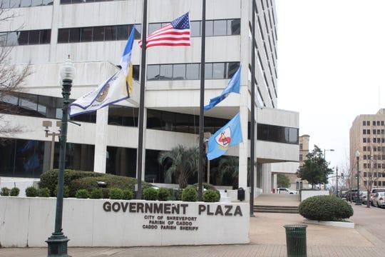 Flags outside of Shreveport Government Plaza at half-staff Monday in honor of slain Shreveport Police Officer Chatéri Payne.