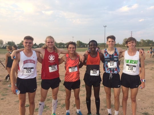 Charlie Sweeney, far left, said he instantly connected with teammate Luke Miller (in red). They ran together for Western Colorado University.