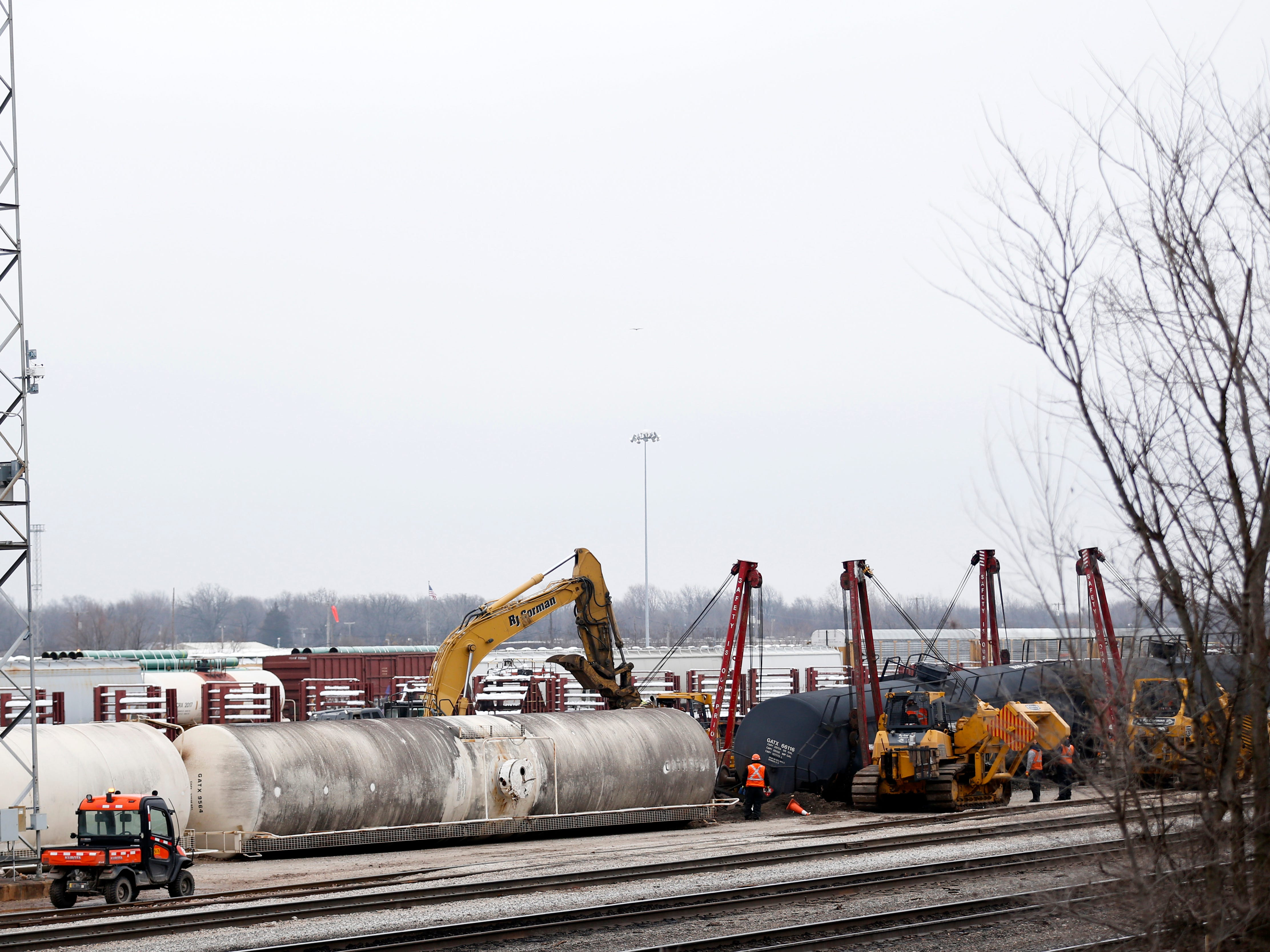 BNSF railroad crews use heavy equipment to lift railcars after they derailed early Monday, Jan. 14, 2019. Four railcars and a locomotive derailed in the rail yard just north of West Division Street near North Brown Avenue.