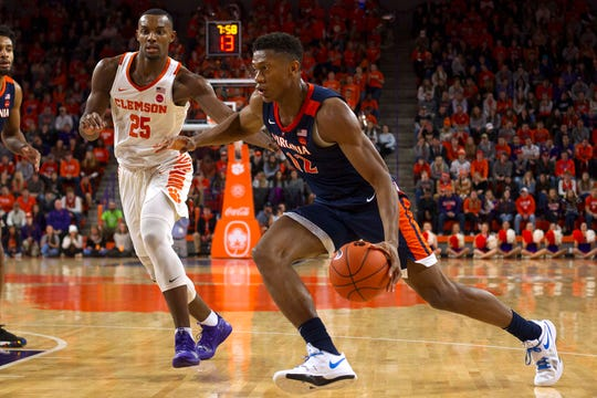 Virginia Cavaliers guard De'Andre Hunter (12) drives to the basket while being defended by Clemson Tigers forward Aamir Simms (25) during the first half of the game at Littlejohn Coliseum.