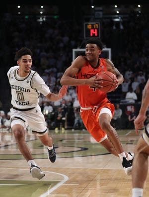 Virginia Tech's Nickeil Alexander-Walker  drives against Georgia Tech's Michael Devoe.
