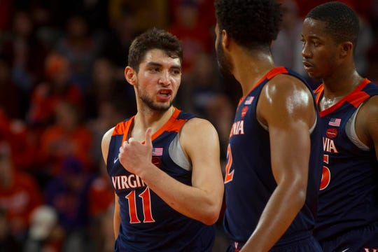 Cavaliers guard Ty Jerome (11) talks with teammates after a timeout during the first half of the game against the Clemson Tigers at Littlejohn Coliseum. Cavaliers won 63-43.